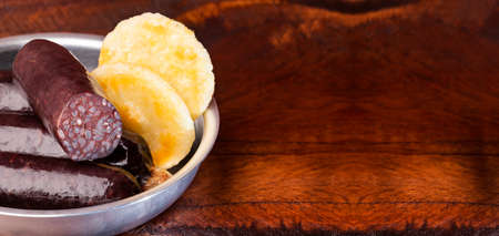 Blood sausage with corn arepa - Colombian food