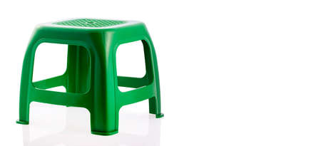 Green plastic chair isolated on white background.