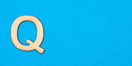 Letter Q in white color on blue background