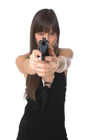 Beautiful girl holding a handgun, focus on gun photo