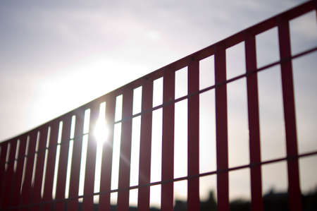 Sun beaming through red railings Stock Photo - 10676098