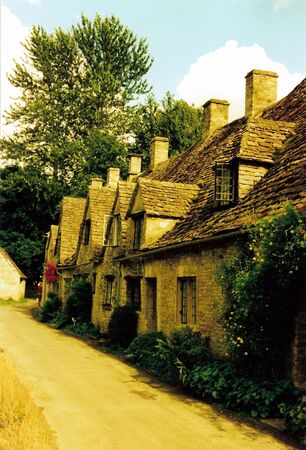 evocative: Arlington Row. One of the most famous of all cotswold scenes. Perfectly evocative of English country life, in warm yellow sunlight in summer. Editorial
