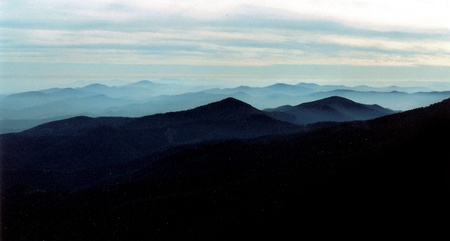 Blue Ridge Mountains in the evening mist, distant mountains and gentle streaming clouds, misty distances of the Blue Ridge Mountain National Park