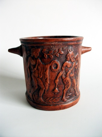 Greek pottery mug, a recently-made pottery mug from Greece, warm terracotta in color, with a traditional Greek scene in bass-relief.
