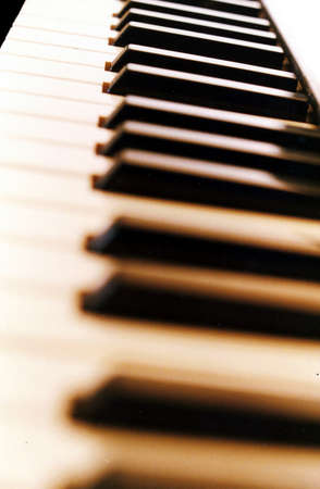Piano keyboard #3, lengthwise shot of a modern piano keyboard with the middle-distance in focus. Stock Photo