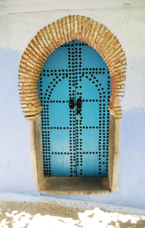 chefchaouen doorway 2, a studded blue wooden doorway in Chefchaouen, Morocco