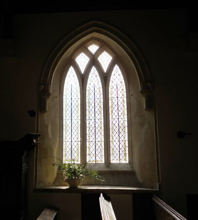 church window: Church window Eastleach, beautiful church window in the 12th Century St  Michael   St  Martin church, Eastleach, Gloucestershire, England Stock Photo