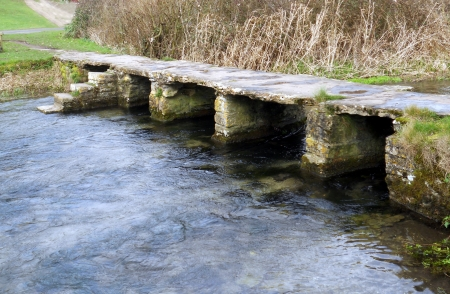 Eastleach bridge 2, an ancient stone slab clapper footbridge in Eastleach, Gloucestershire, England photo
