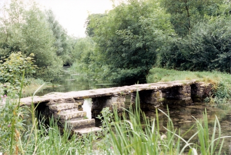 eastleach bridge, an ancient stone slab clapper footbridge in Eastleach, Gloucestershire, England photo