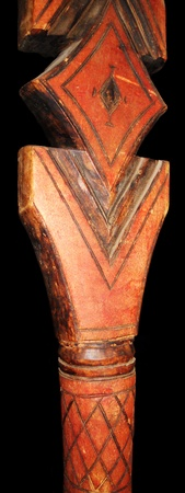 woodcarving: Moroccan woodcarving, top of a wooden staff with carved and colored decoration