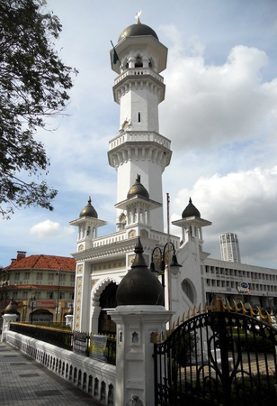 Mosque Minaret Penang, the white minaret on the corner of a Mosque in Georgetown, Penang, Malaysia