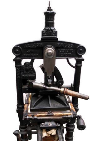 old printing press, a small old printing press photo
