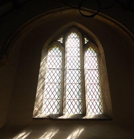 ancient church window 2, small church window in a sunny 12th Century Church interior