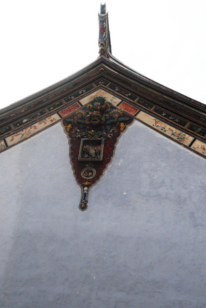 ornate roof end of Chinese temple in Saigon, Vietnam