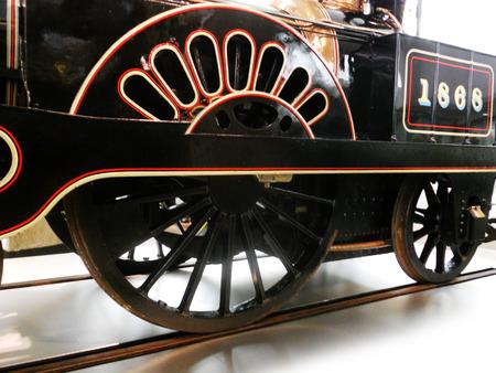 steam train closeup, showing wheel and tracks