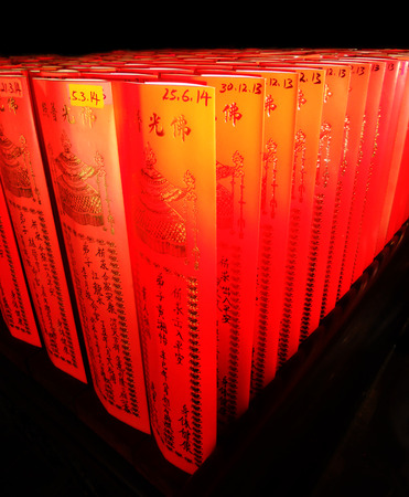 Chinese religious symbols on red paper, Chinese temple, Vietnam Stock Photo