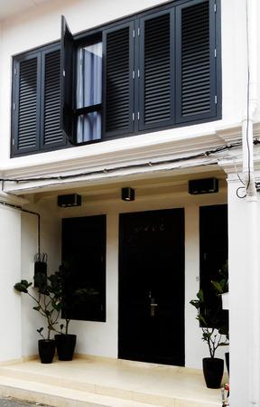 Restored Sino-portuguese architecture in South East Asia, cream and black