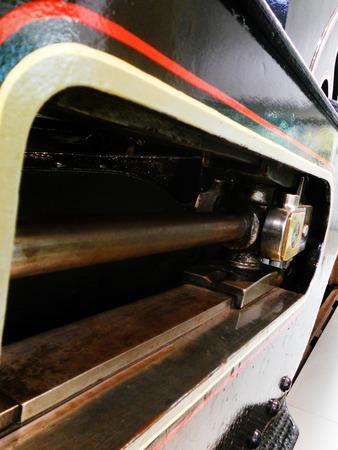 Steam train closeup showing piston-rod Stock Photo