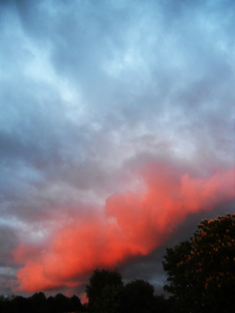 Clouds with dramatic sunset reds
