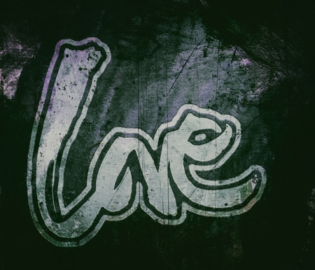 love painted, the word love hand-painted, artistic word love in street-style lettering with grunge texture, dark colors. 版權商用圖片