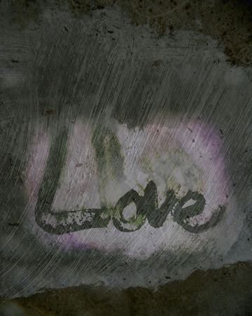 love painted, the word love hand-painted, artistic word love, rough painted partially washed-out brush lettering on wet paper with ink running on grunge painted texture.