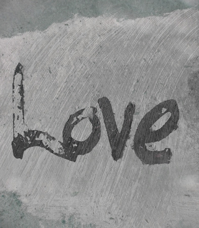 love painted, the word love hand-painted, artistic word love, rough painted partially washed-out brush lettering on painted concrete texture, grays. Imagens