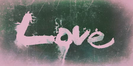 love painted, the word love hand-painted, artistic word love, brush lettering partially washed-out on wet paper with ink running on painted grunge texture, pink and green colored tints, vignette.