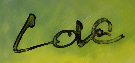 love painted, the word love hand-painted, artistic word love, brush lettering partially washed-out on wet paper with indian ink on blurred painted background. Banco de Imagens