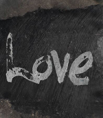 love painted, the word love hand-painted, artistic word love, rough painted partially washed-out brush lettering on painted concrete texture, grays. Banco de Imagens
