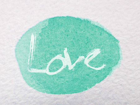 love painted, the word love hand-painted, artistic word love, pale rough brushed lettering on watercolor texture oval, cyan tint.