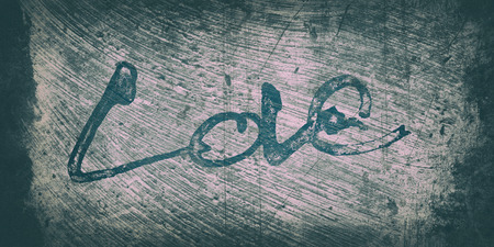 love painted, the word love hand-painted, artistic word love, brush lettering partially washed-out on wet paper with indian ink  on painted grunge texture background, pink and blue tints with dark vignette. Imagens