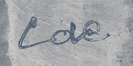 love painted, the word love hand-painted, artistic word love, brush lettering partially washed-out on wet paper with indian ink  on painted grunge texture background, grays. Banco de Imagens