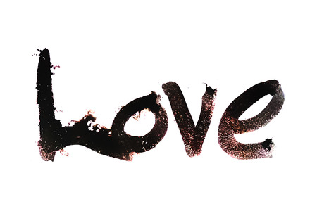 love painted, the word love hand-painted, artistic word love, brush lettering partially washed-out on wet paper with ink running on white background. Banco de Imagens