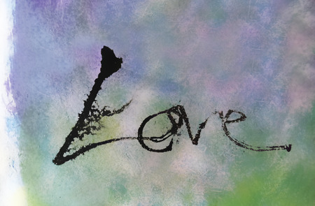 love painted, the word love hand-painted, artistic word love, brush lettering partially washed-out on wet paper with indian ink running on blurred painted grunge texture. Banco de Imagens