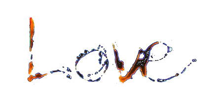 love painted, the word love hand-painted, artistic word love, blue and orange tinted brush painted lettering with paint beading on greasy white surface. Stock Photo