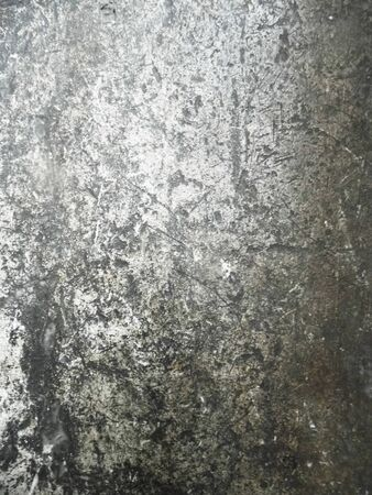 Distressed plaster surface with scratches and marks, grunge background texture. Stock Photo