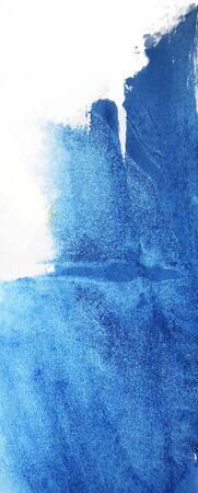 Blue paint on textured paper, partially opaque blue paint natural texture on white background. Фото со стока