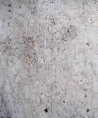 Old dirty white paint flaking, with scratches and dirt, paint grunge background texture.
