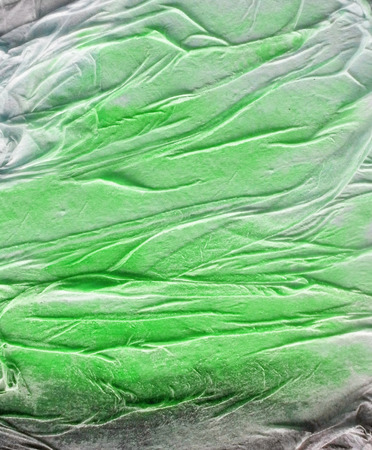Organic texture made by glue crumpled tissue on painted board, tints of black, green and white. Stock Photo