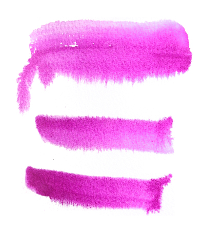 3 rough brush-strokes in magenta semi-transparent water-based paint on damp rough watercolor paper, with white background. Stock Photo