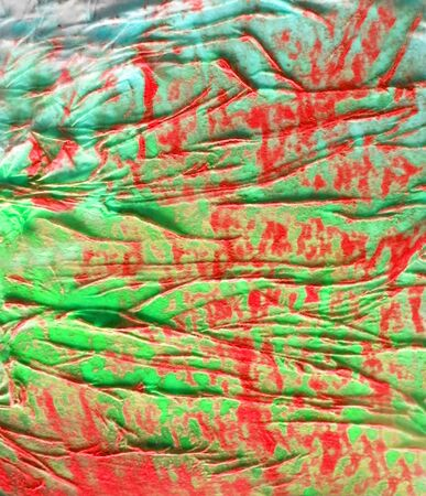 Organic texture, with paint and pastels, made by glue crumpled tissue on painted board, red and green.