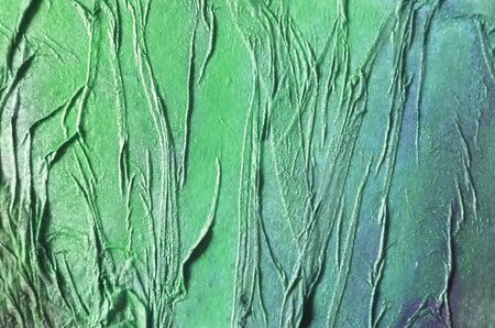 Painted organic texture made by glue crumpled tissue on painted board, green and blue.