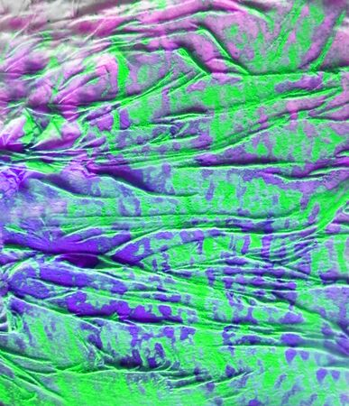 Organic texture, with paint and pastels, made by glue crumpled tissue on painted board, green and purple. Stock Photo