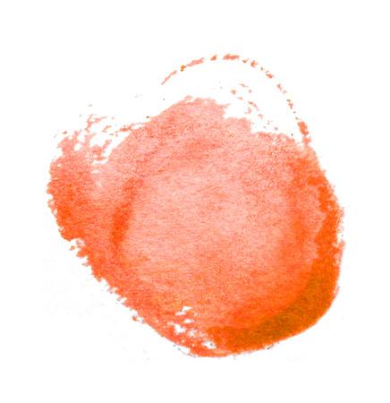 Watercolor circle, roughly circular orange watercolor painted area on rough watercolor paper, isolated on white background.