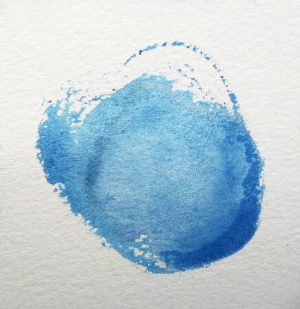 Watercolor circle, roughly circular blue watercolor painted area on rough watercolor paper.