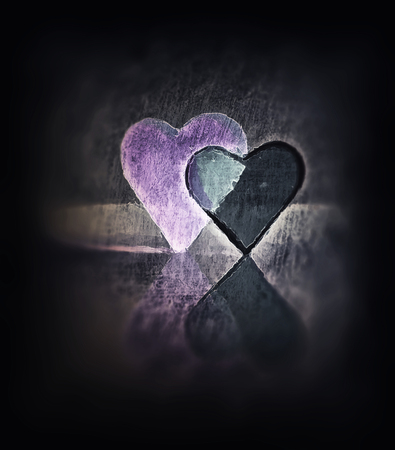Sketched 3D heart shapes, watercolor style image of two glass hearts close together, one transparent, standing up, purple tints and diffuse edges and dark blur vignette.