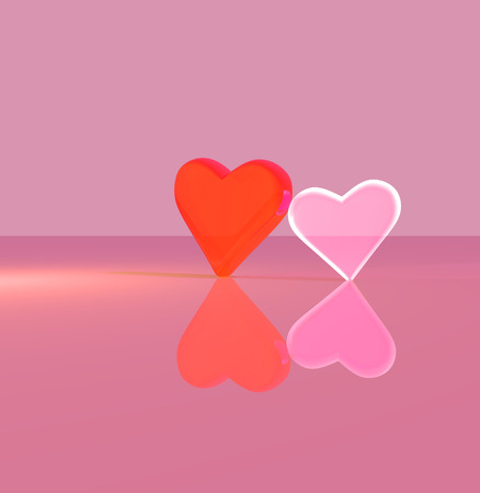 A pair of 3D heart shapes, two upright glass hearts leaning against each other, one transparent, on a shiny surface, lit by multiple light sources, orange and red tints.