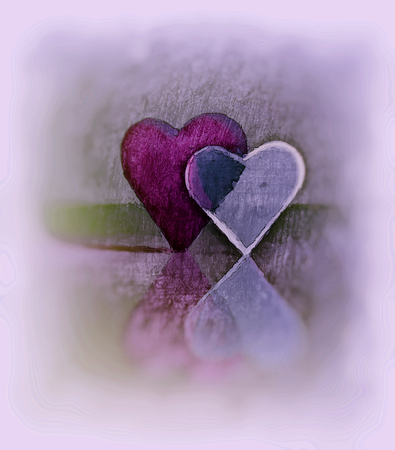 Sketched 3D heart shapes, watercolor style image of two glass hearts close together, one transparent, standing up on a shiny surface, magenta tints, diffuse edges and blur vignette.