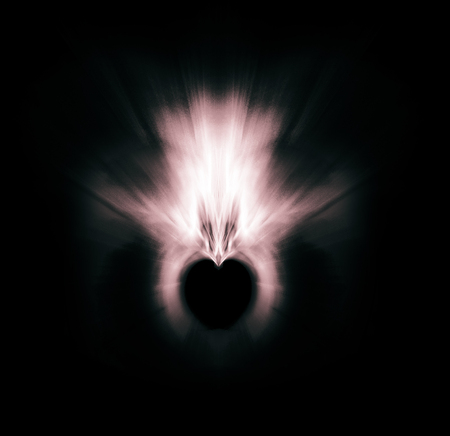 Processed Fractal heart, a beautiful symmetrical fractal processed with a zoom blur, creating a small heart-shaped negative space, pale colors with pink tints, on black background. Фото со стока