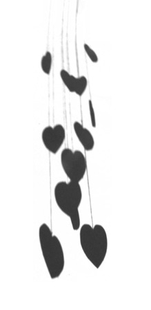 Hanging hearts shadows, the shadows made by a group of small hearts hanging at different heights on rough threads, grays. Banco de Imagens